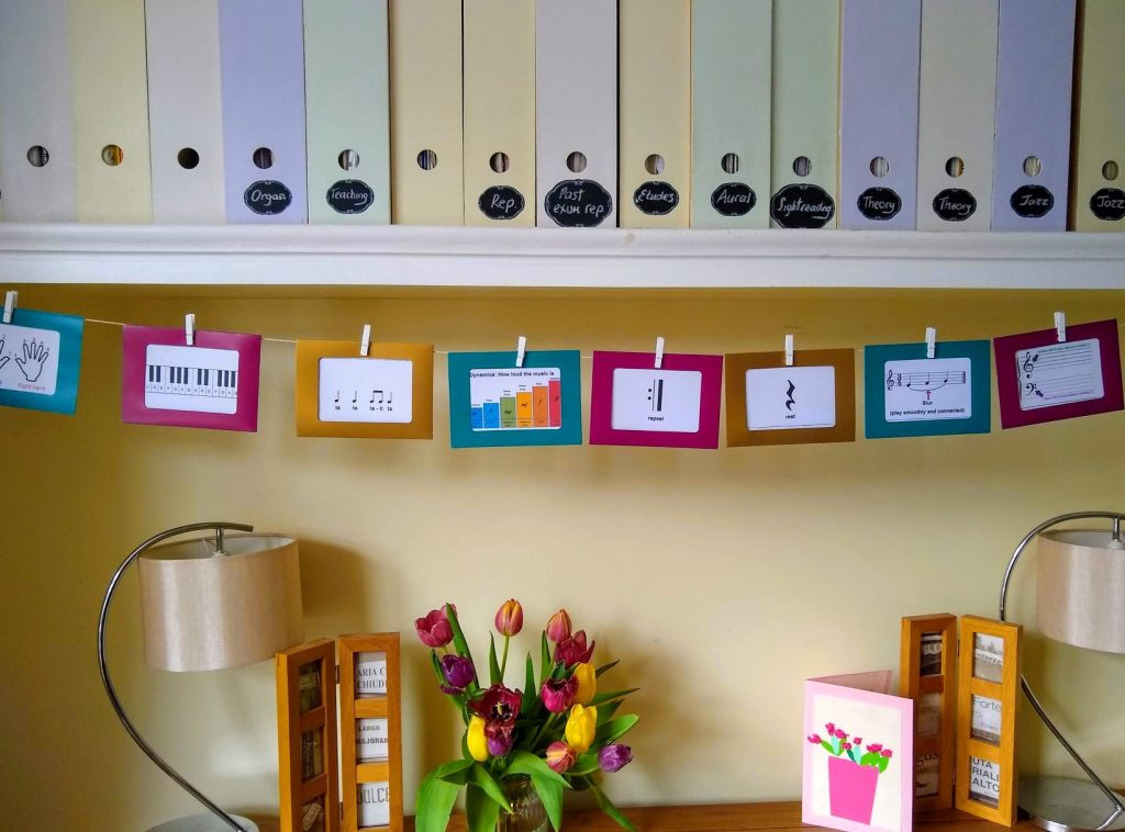 Photo garland display beginner piano lessons Didsbury Manchester